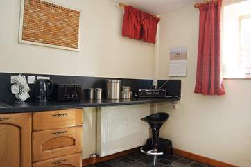 There is a breakfast-bar in the kitchen-area.