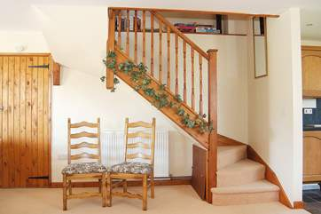 Stairs lead up from the open plan living-room.
