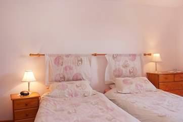 Bedroom 3 has twin beds and en suite shower-room.