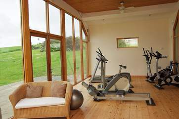 The gym is equipped with a running machine, rowing machine, elliptical trainer and two exercise bikes.