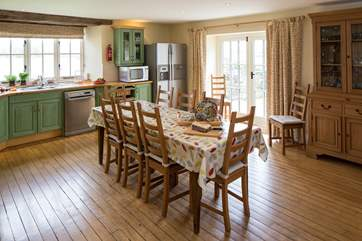 The very spacious kitchen/diner has doors out to an enclosed patio.