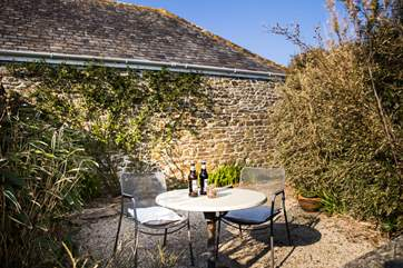 A sunny and shady spot depending on the time of day with views over the surrounding countryside.