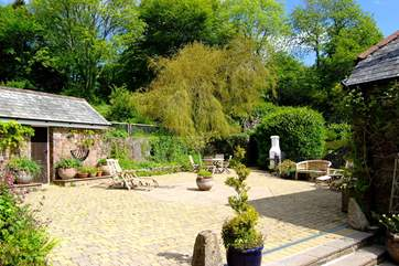 The sunny courtyard outside the cottage.