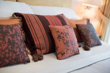 Gorgeous silk cushions dress the bed (all bed linen is from The White Company).
