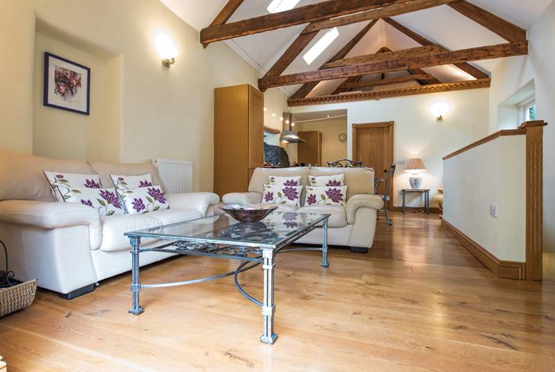 Gorgeous old beams, oak floors and bespoke oak joinery show the superb quality of this delightful cottage.