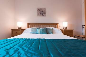A super-comfortable king-size bed (5') in Bedroom 1.