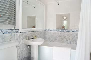 The bathroom with three-quarter size bath.