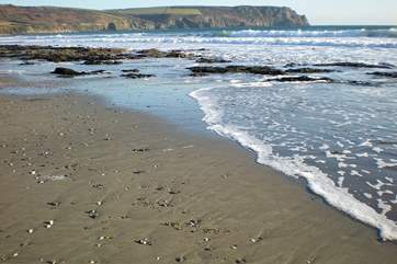 Pendower beach as the tide comes in.