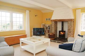 The sitting-room with cosy wood-burner.