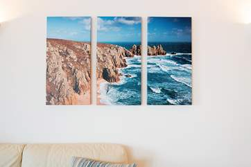 The wonderful coastal artwork throughout the apartment brings the outside in.