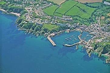 Mevagissey from the air (Marine Point is in the clifftop building to the immediate left of the grassed area on the left).