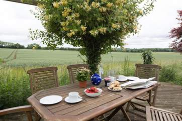 The rear terrace opens out onto fields with wide expansive views.