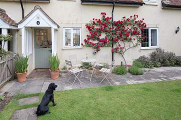 The pretty front garden is fully enclosed so that you can relax with your four-legged friend.