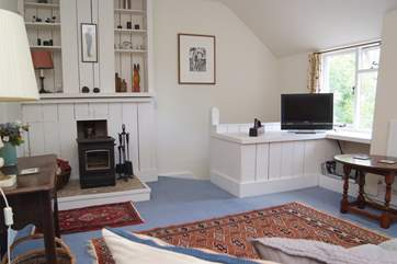 The sitting-room is on the first floor and has a cosy wood-burner.