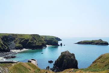 The view from the clifftop beside the renowned Mullion Cove Hotel, looking down towards the harbour entrance.