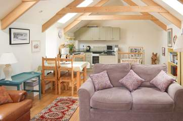 The first floor open plan living-room is light and spacious but also cosy.