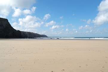 Chapel Porth beach at low tide.