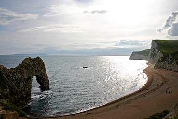 Looking west along the coast from Durdle Door. The Isle of Portland is visible in the distance.