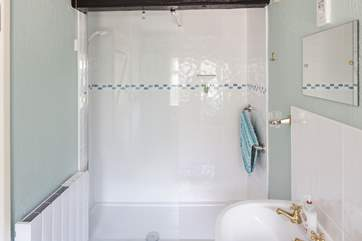 The spacious en suite shower-room has a large walk-in shower.