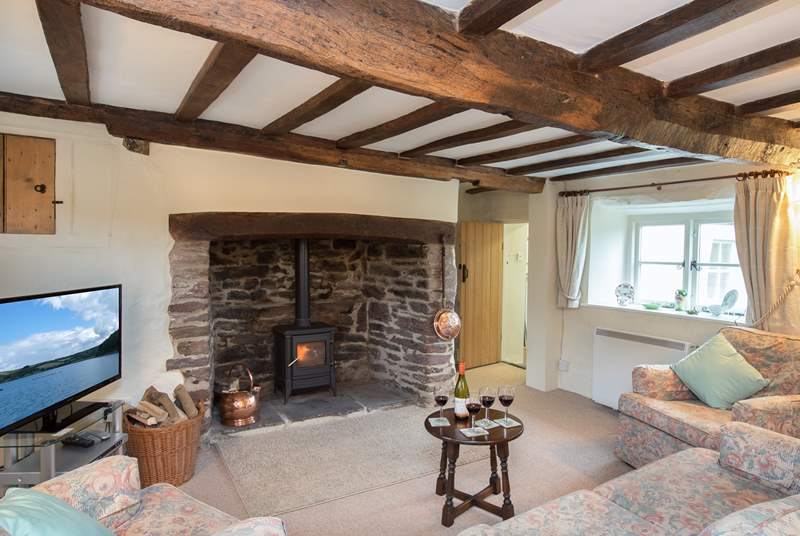 There is a spacious but very cosy living-room with a wonderful inglenook fireplace and wood-burner.