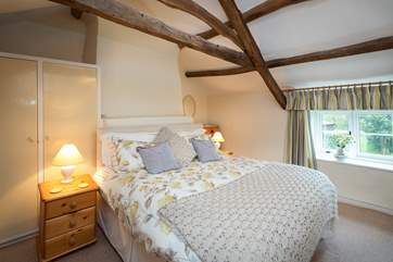 The master bedroom has a super-king size bed and views over the very pretty garden.