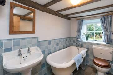 The bathroom on the ground floor has a lovely roll-top bath.