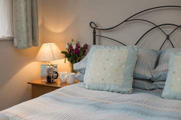 Lovely bed linens and soft furnishings make this a very welcoming cottage.