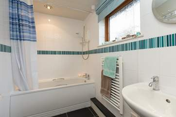 This is the bathroom, offering the option of both a bath and a shower.
