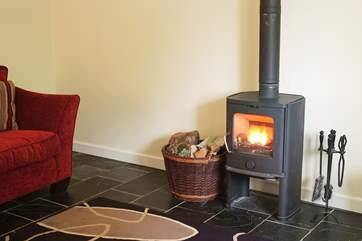 The contemporary wood-burner will keep you warm whatever the weather.