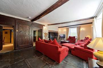The very spacious sitting-room has a wood-burner and a huge television!