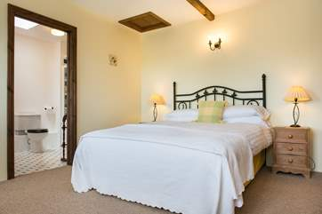 The bedroom in the attached annexe has its own en suite.