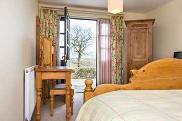 You can enjoy the countryside views from the bedroom.