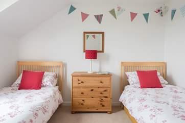 Bedroom 4 has twin beds.