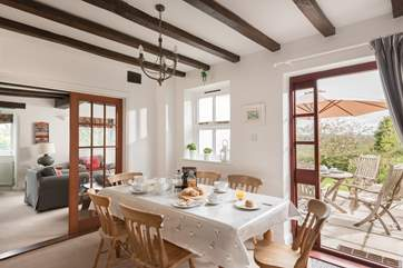 The dining-room links the sitting-room and kitchen, with a door out to the dining terrace.
