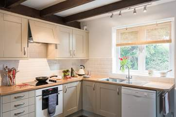 The Shaker-style kitchen is very well-equipped.