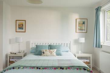 A king-size (5') bed in Bedroom 1.