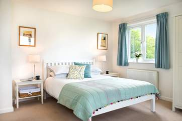 Bedroom One is wonderfully light and airy