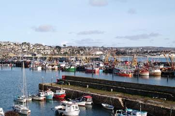 Newlyn harbour, just one mile away.