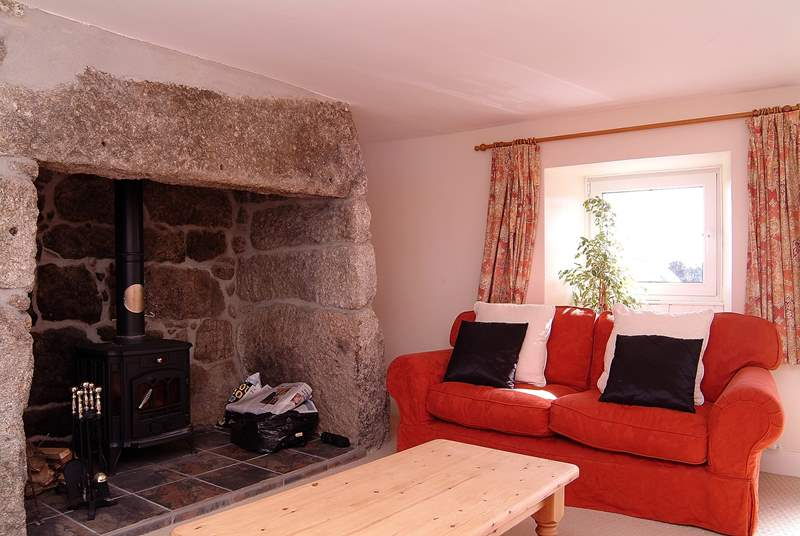 The second sitting-room has a large wood-burner.