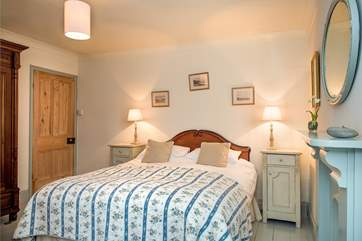 There are lovely period features throughout the property (Bedroom 1).