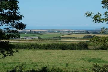 The wonderful view from the first floor across open countryside to the stunning north Cornwall coastline.