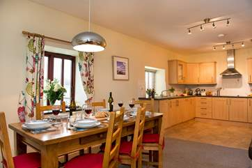 It will be easy serving up meals with the dining-table situated close to the kitchen.