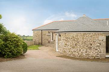 Gilly Barn is a semi-detached converted single barn with living rooms on the ground floor and bedrooms below.