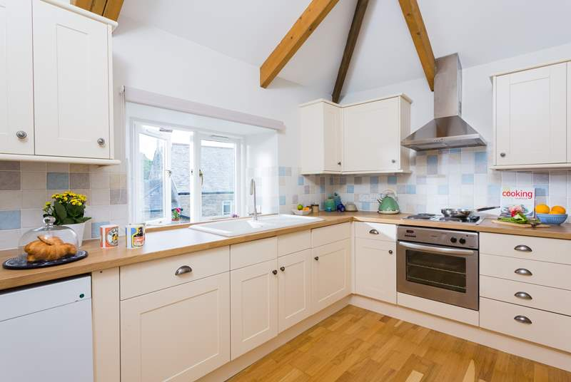 The well-equipped kitchen is on the first floor just along from the living-room.