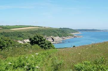 Looking towards Falmouth and the Roseland peninsula in the distance from the coastal footpath near Opie's Toy.