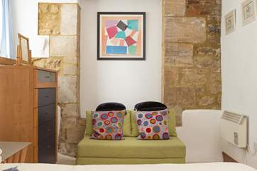 There are colourful artistic touches throughout  this cheerful property.