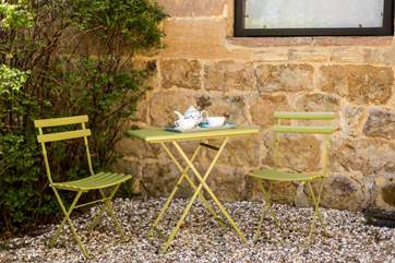 Enjoy an early morning coffee at this little bistro-table.
