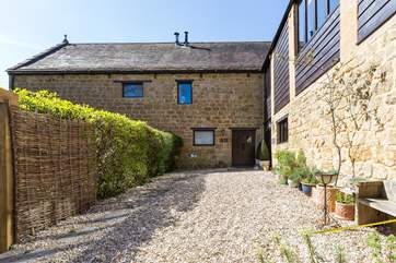 Flax Barn is this corner property in the historic Priory Barns development.