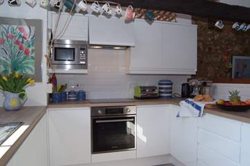 The fabulous new kitchen design complements the traditional features of this lovely barn conversion.