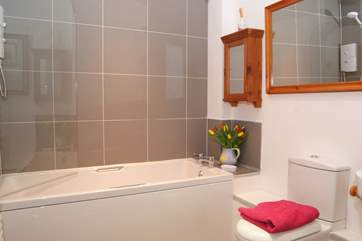 This is the brand new bathroom, with its fitted shower and stylish contemporary tiles.